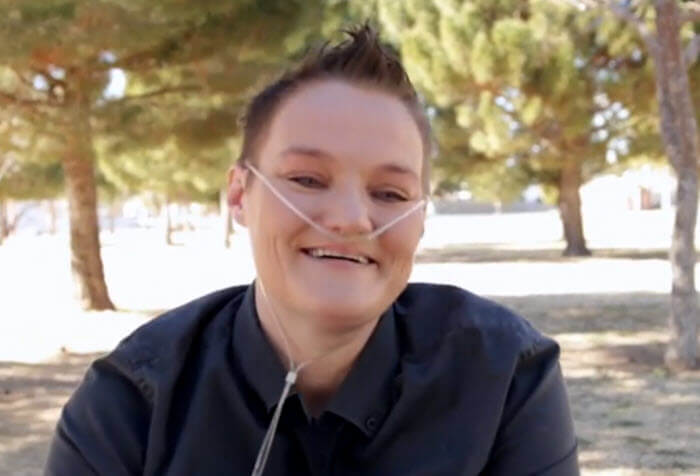smiling woman with nasal oxygen tube
