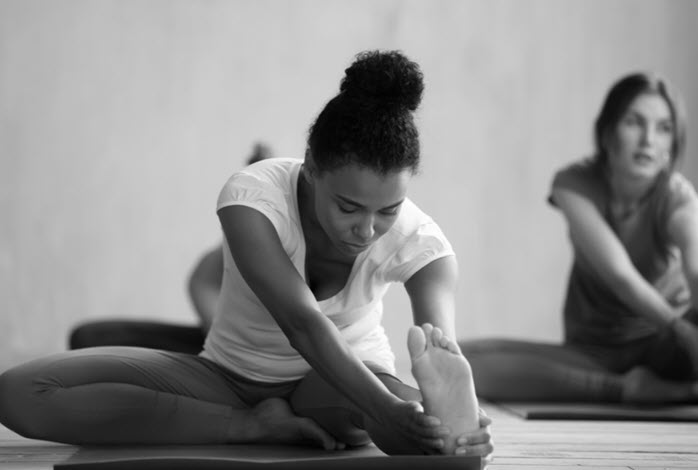 young woman participates in yoga class
