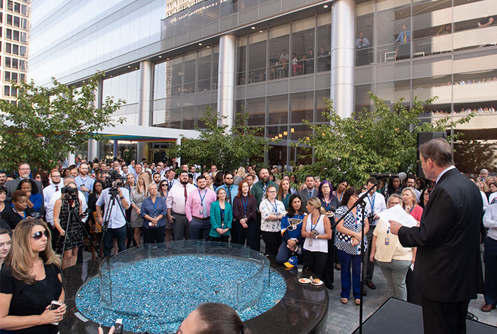 Michael Neidorff speaks in front of Centene Corporate Headquarters in Clayton, MO.