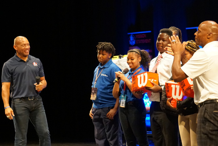 Aeneas Williams and Darrell Green interact with students on stage