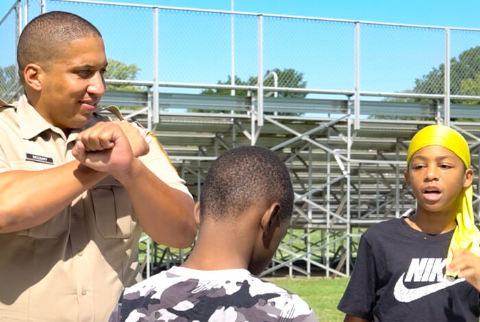 police officer engages with youth