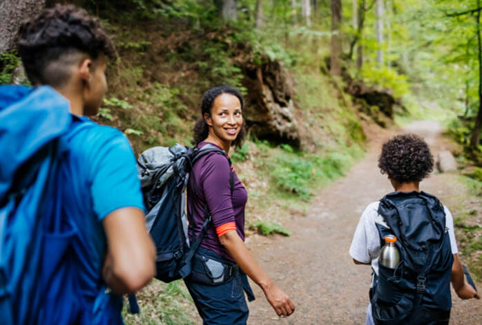 African American family hikes outdoors