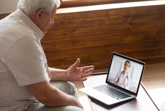 mature man consulting a doctor on his laptop