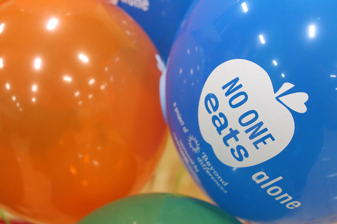 Balloons at school for No One Eats Alone Day